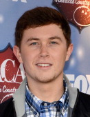 Singer Scotty McCreery arrives at the American Country Awards 2013 at the Mandalay Bay Events Center on December 10 2013 in Las Vegas Nevada