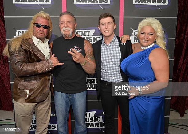 Singer Scotty McCreery joins TV personalities Duane Dog Lee Chapman Paul Teutul Sr and Beth Chapman attend the 2013 CMT Music awards at the...