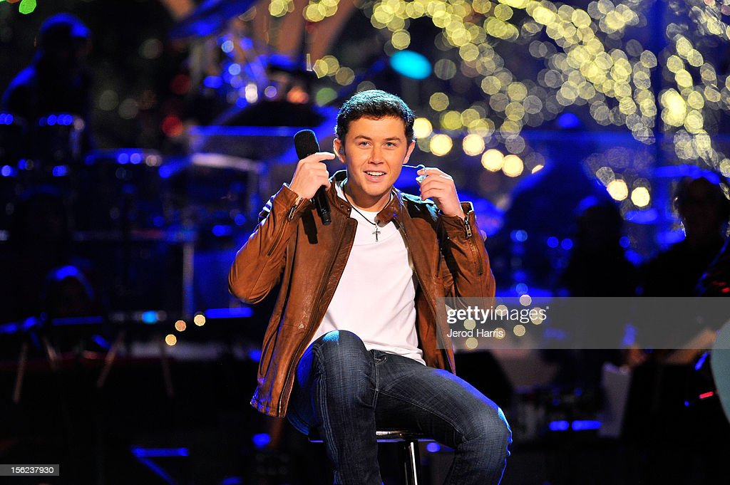Singer <a gi-track='captionPersonalityLinkClicked' href=/galleries/search?phrase=Scotty+McCreery&family=editorial&specificpeople=7520936 ng-click='$event.stopPropagation()'>Scotty McCreery</a> performs at A Hollywood Christmas Celebration at The Grove on November 11, 2012 in Los Angeles, California.