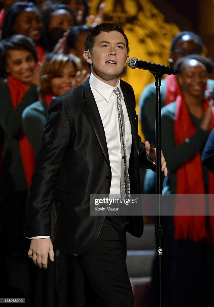 Singer <a gi-track='captionPersonalityLinkClicked' href=/galleries/search?phrase=Scotty+McCreery&family=editorial&specificpeople=7520936 ng-click='$event.stopPropagation()'>Scotty McCreery</a> performs onstage during TNT Christmas in Washington 2012 at National Building Museum on December 9, 2012 in Washington, DC. 23098_003_KM_1052.JPG