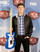 Singer Scotty McCreery poses with Breakthrough Artist of the Year award in the press room during the American Country Awards 2013 at the Mandalay Bay...