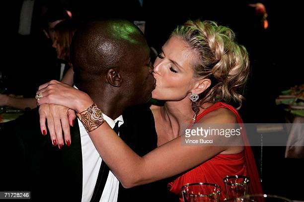 Singer Seal and actress Heidi Klum kiss at the Governor's Ball after the 58th Annual Primetime Emmy Awards at the Shrine Auditorium on August 27 2006...