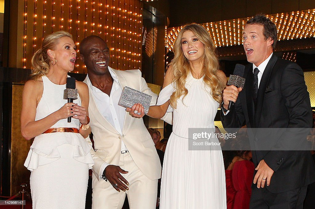 Singer Seal and <a gi-track='captionPersonalityLinkClicked' href=/galleries/search?phrase=Delta+Goodrem&family=editorial&specificpeople=201895 ng-click='$event.stopPropagation()'>Delta Goodrem</a> are interviewed by <a gi-track='captionPersonalityLinkClicked' href=/galleries/search?phrase=Sonia+Kruger&family=editorial&specificpeople=215269 ng-click='$event.stopPropagation()'>Sonia Kruger</a> (L) and Jules Lund (R) as they arrive at the 2012 Logie Awards at the Crown Palladium on April 15, 2012 in Melbourne, Australia.