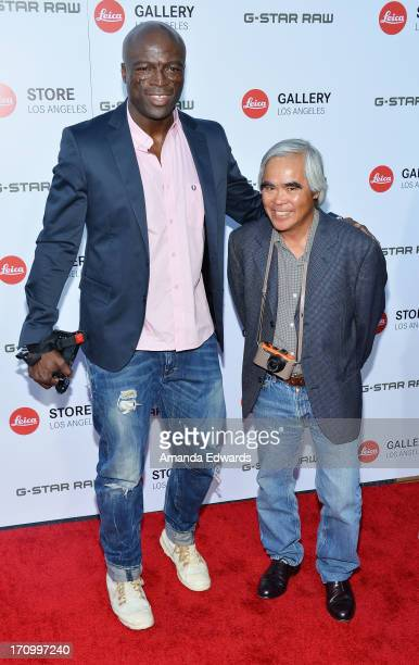 Singer Seal and photographer Nick Ut arrive at the Leica Store Los Angeles Grand Opening at Leica on June 20 2013 in Los Angeles California