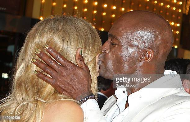 Singer Seal kisses Delta Goodrem as they arrive at the 2012 Logie Awards at the Crown Palladium on April 15 2012 in Melbourne Australia