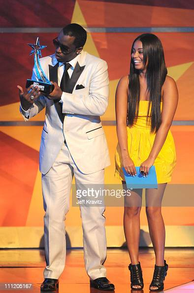 Singer Sean 'Diddy' Combs and actress Lauren London on stage during the 2008 BET Awards at the Shrine Auditorium on June 24 2008 in Los Angeles...