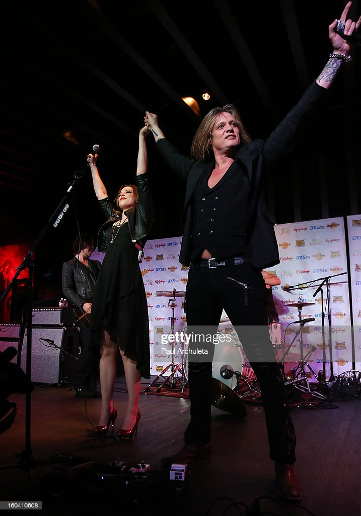 Singer <a gi-track='captionPersonalityLinkClicked' href=/galleries/search?phrase=Sebastian+Bach&family=editorial&specificpeople=583692 ng-click='$event.stopPropagation()'>Sebastian Bach</a> (R) and Lzzy Hale (L) perform with her Band Halestorm at the 5th annual Revolver Golden Gods Awards nominee announcements at the Hard Rock Cafe Hollywood on January 30, 2013 in Hollywood, California.