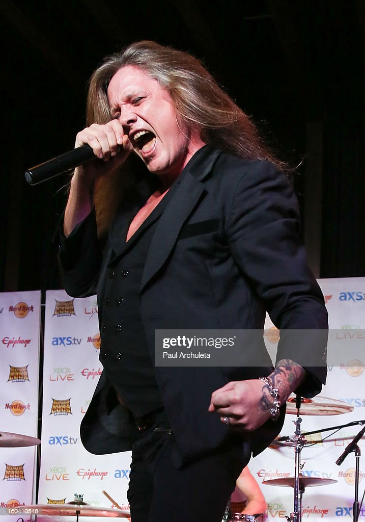 Singer <a gi-track='captionPersonalityLinkClicked' href=/galleries/search?phrase=Sebastian+Bach&family=editorial&specificpeople=583692 ng-click='$event.stopPropagation()'>Sebastian Bach</a> performs with the Metal Band Halestorm at the 5th annual Revolver Golden Gods Awards nominee announcements at the Hard Rock Cafe Hollywood on January 30, 2013 in Hollywood, California.