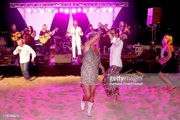 Singer Sebastien El Chato performs at President of the Union of Showmen Marcel Campion's Party at 'La Bouillabaisse' beach on August 6 2013 in...