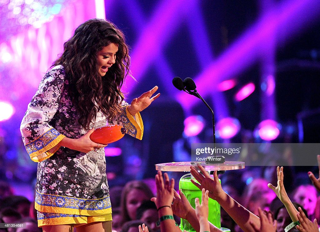 Singer Selena Gomez accepts the Favorite Female Singer award onstage during Nickelodeon's 27th Annual Kids' Choice Awards held at USC Galen Center on March 29, 2014 in Los Angeles, California.