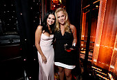 Singer Selena Gomez and Hollywood Comedy Award honoree Amy Schumer pose onstage during the 19th Annual Hollywood Film Awards at The Beverly Hilton...