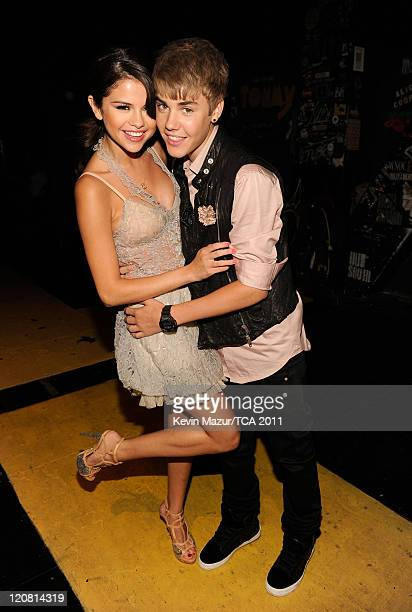 Singer Selena Gomez and musician Justin Bieber attend the 2011 Teen Choice Awards at Gibson Universal Amphitheatre on August 7 2011 in Universal City...