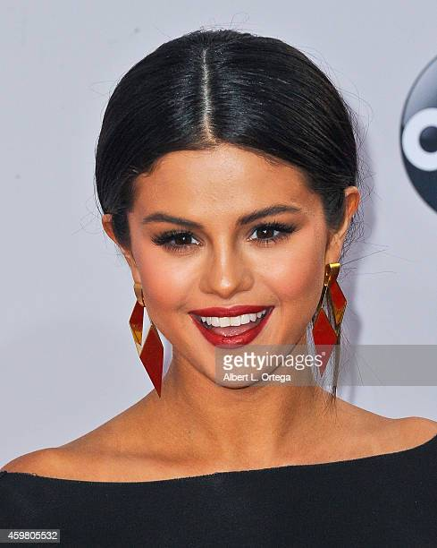 Singer Selena Gomez arrives for the 42nd Annual American Music Awards held at Nokia Theatre LA Live on November 23 2014 in Los Angeles California