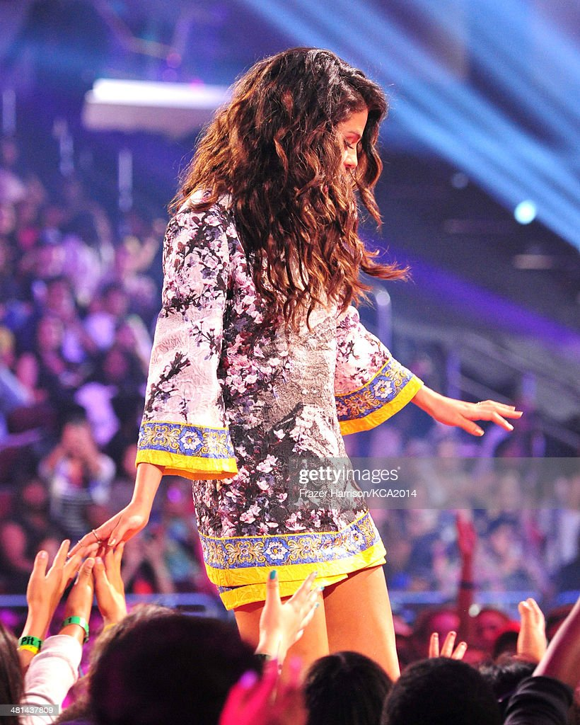 Singer Selena Gomez onstage during Nickelodeon's 27th Annual Kids' Choice Awards held at USC Galen Center on March 29, 2014 in Los Angeles, California.