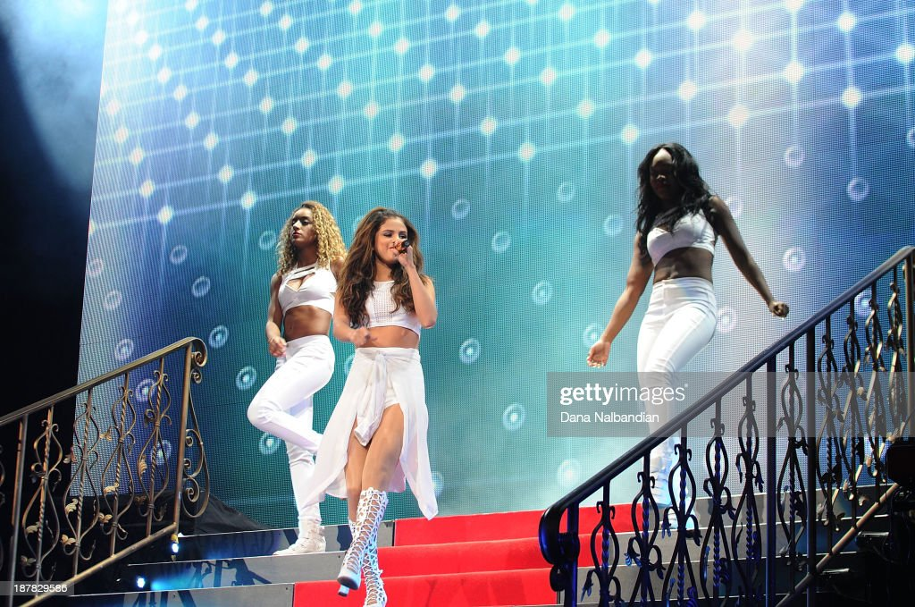 Singer <a gi-track='captionPersonalityLinkClicked' href=/galleries/search?phrase=Selena+Gomez&family=editorial&specificpeople=4295969 ng-click='$event.stopPropagation()'>Selena Gomez</a> performs at Key Arena on November 12, 2013 in Seattle, Washington.