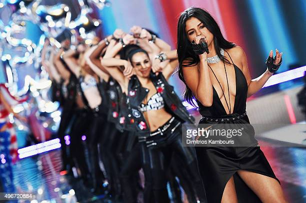 Singer Selena Gomez performs on the runway with dancers during the 2015 Victoria's Secret Fashion Show at Lexington Avenue Armory on November 10 2015...