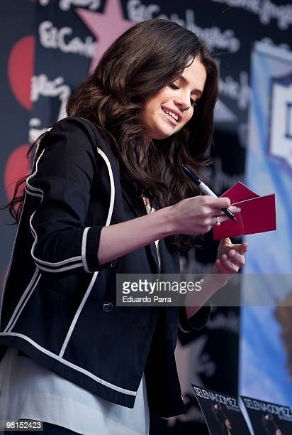 Singer Selena Gomez signs autographs during the photocall for her new album 'Kiss tell'' at the El Corte Ingles mall on March 30 2010 in Madrid Spain