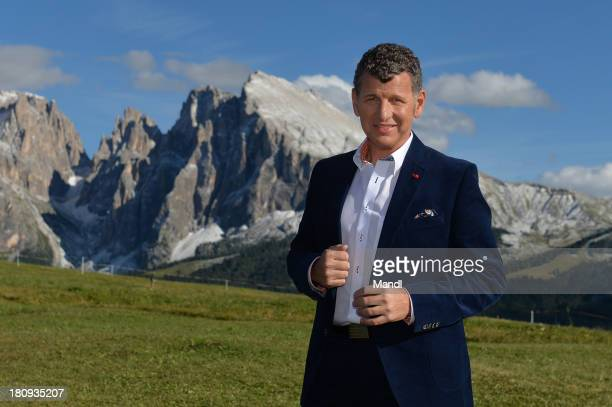 Singer Semino Rossi poses for media after the recording of the TV Show 'ZDF Fernsehgarten' at Seiser Alm on September 17 2013 in Kastelruth Italy