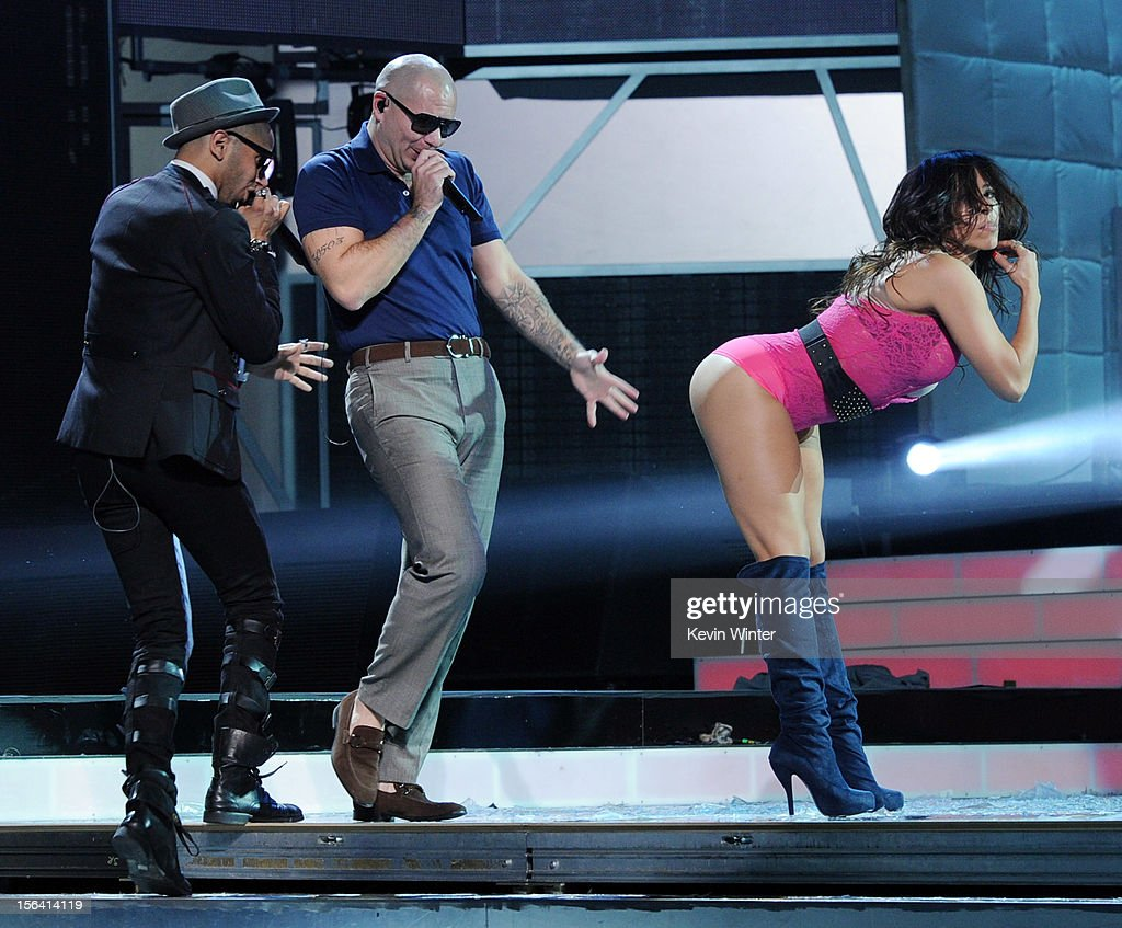 Singer Sensato (L) and rapper Pitbull (C) perform with a dancer onstage during rehearsals for the 13th annual Latin GRAMMY Awards at the Mandalay Bay Events Center on November 14, 2012 in Las Vegas, Nevada.