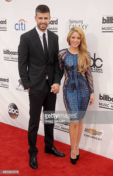 Singer Shakira and Gerard Pique arrive at the 2014 Billboard Music Awards at the MGM Grand Garden Arena on May 18 2014 in Las Vegas Nevada