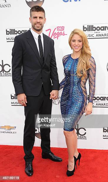 Singer Shakira and Gerard Pique arrive at the 2014 Billboard Music Awards at the MGM Grand Hotel and Casino on May 18 2014 in Las Vegas Nevada