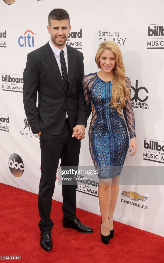 Singer <a gi-track='captionPersonalityLinkClicked' href=/galleries/search?phrase=Shakira&family=editorial&specificpeople=160650 ng-click='$event.stopPropagation()'>Shakira</a> and <a gi-track='captionPersonalityLinkClicked' href=/galleries/search?phrase=Gerard+Pique&family=editorial&specificpeople=227191 ng-click='$event.stopPropagation()'>Gerard Pique</a> arrive at the 2014 Billboard Music Awards at the MGM Grand Garden Arena on May 18, 2014 in Las Vegas, Nevada.