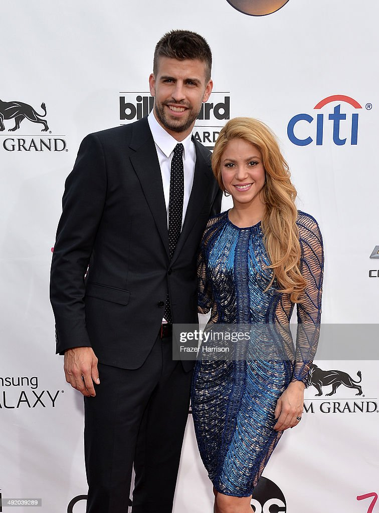 Singer <a gi-track='captionPersonalityLinkClicked' href=/galleries/search?phrase=Shakira&family=editorial&specificpeople=160650 ng-click='$event.stopPropagation()'>Shakira</a> (R) and soccer player <a gi-track='captionPersonalityLinkClicked' href=/galleries/search?phrase=Gerard+Pique&family=editorial&specificpeople=227191 ng-click='$event.stopPropagation()'>Gerard Pique</a> attend the 2014 Billboard Music Awards at the MGM Grand Garden Arena on May 18, 2014 in Las Vegas, Nevada.
