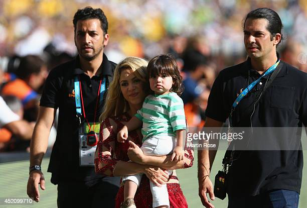 Singer Shakira and son Milan Pique look on during the closing ceremony prior to the 2014 FIFA World Cup Brazil Final match between Germany and...