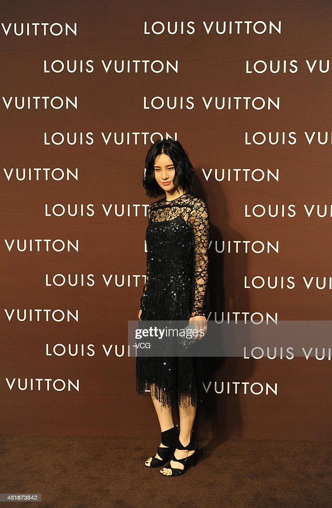 Singer Shang Wenjie attends Louis Vuitton flagship store opening ceremony at Chengdu IFS on July 3, 2014 in Chengdu, China.