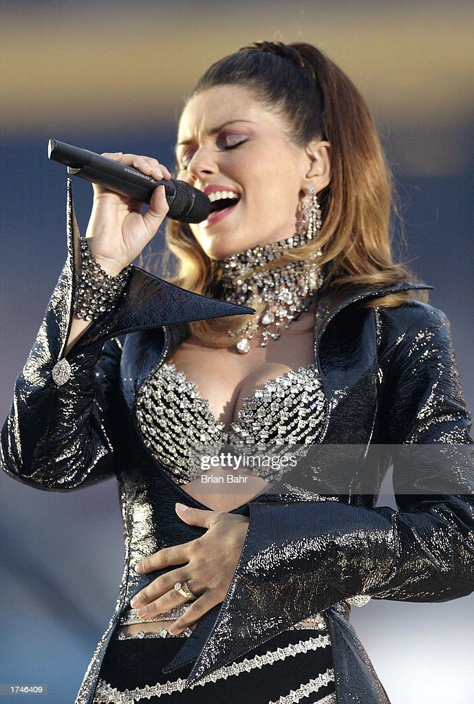 Singer Shania Twain performs during halftime at Super Bowl XXXVII between the Tampa Bay Buccaneers and the Oakland Raiders on January 26, 2003 at Qualcomm Stadium in San Diego, California.
