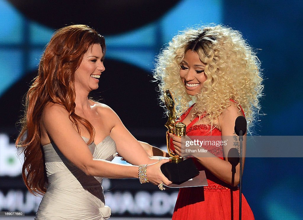 Singer Shania Twain presents the award for Top Rap Artist to recording artist Nicki Minaj onstage during the 2013 Billboard Music Awards at the MGM Grand Garden Arena on May 19, 2013 in Las Vegas, Nevada.