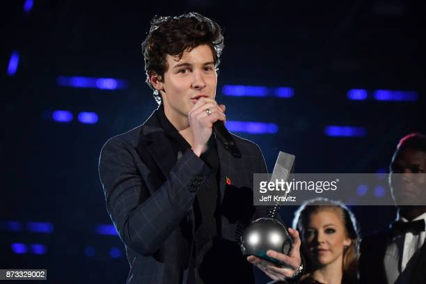 Singer Shawn Mendes accepts the award for best song on stage during the MTV EMAs 2017 held at The SSE Arena Wembley on November 12 2017 in London...
