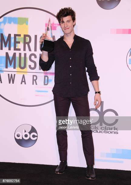 Singer Shawn Mendes poses in the press room at the 2017 American Music Awards at Microsoft Theater on November 19 2017 in Los Angeles California