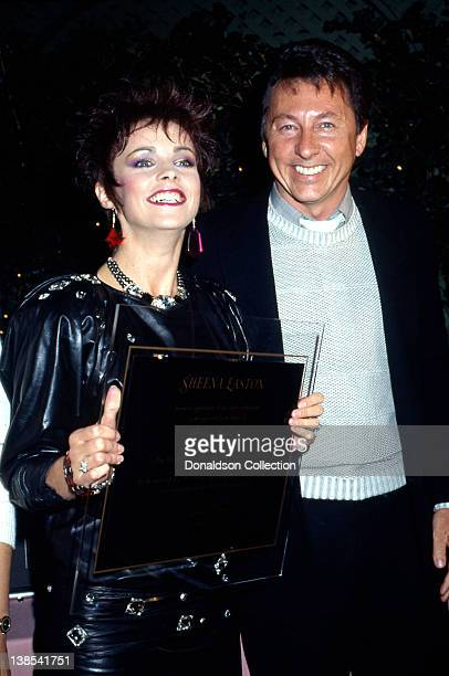 Singer Sheena Easton receives a commemorative plaque to celebrate her being the only artist in the history of Billboard Magazine to realize top 5...