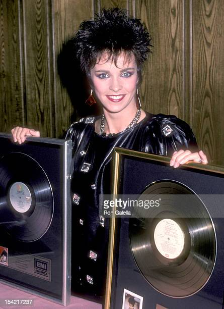 Singer Sheena Easton receives Platinum and Gold Record Awards for her album 'Private Heaven' on March 13 1985 at Chasen's Restaurant in Beverly Hills...