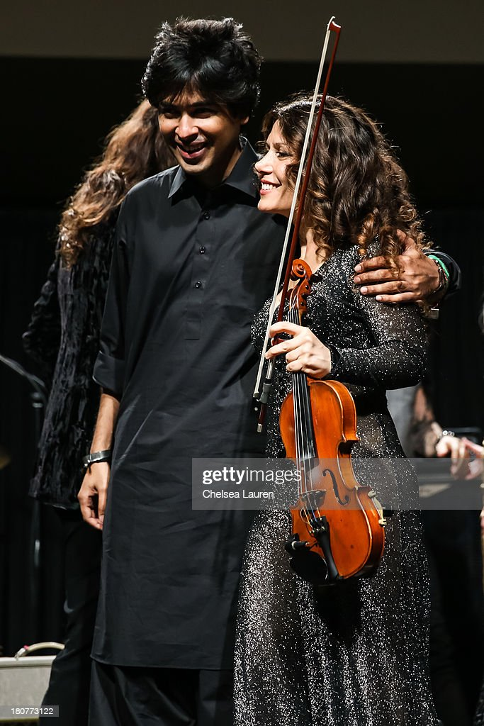 Singer Shehzad Roy (L) and violinist Lili Haydn perform at Adopt the Arts' Peace Through Music celebrity gala at Loews Hollywood Hotel on September 15, 2013 in Hollywood, California.