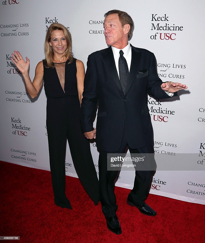Singer Sheryl Crow (L) and actor Joe Piscopo attend the USC Institute of Urology Changing Lives and Creating Cures Gala at the Beverly Wilshire Four Seasons Hotel on November 20, 2014 in Beverly Hills, California.