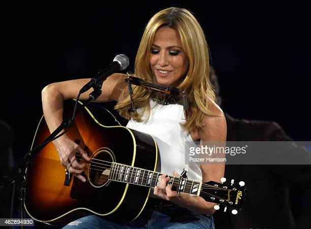 Singer Sheryl Crow performs onstage at the 25th anniversary MusiCares 2015 Person Of The Year Gala honoring Bob Dylan at the Los Angeles Convention...