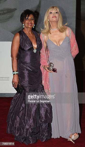 Singer Shirley Bassey and TV Presenter Amanda Lear attend the Red Cross ball on July 27 2007 in Monte Carlo France