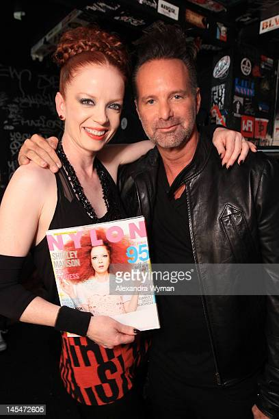 Singer Shirley Manson of Garbage and editor in chief of NYLON Marvin Scott Jarrett attend NYLON and Garbage Celebrate the Annual June/July Music...
