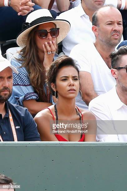 Singer Shy'm watching the match of her companion Benoit Paire against Rafael Nadal during the 2017 French Tennis Open Day Two at Roland Garros on May...