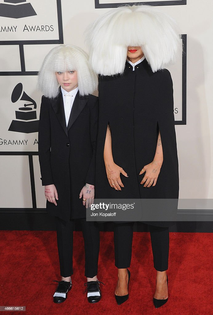 Singer Sia (R) and dancer Maddie Ziegler arrive at the 57th GRAMMY Awards at Staples Center on February 8, 2015 in Los Angeles, California.