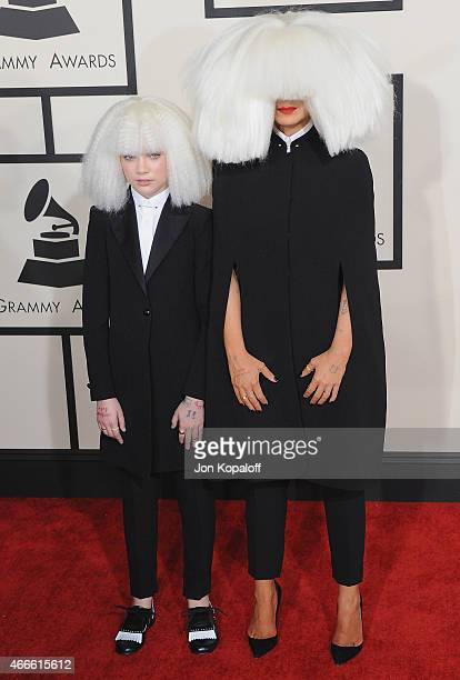 Singer Sia and dancer Maddie Ziegler arrive at the 57th GRAMMY Awards at Staples Center on February 8 2015 in Los Angeles California
