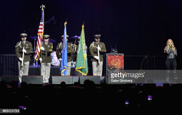 Singer Siena Paglia performs the American national anthem as the Las Vegas Metropolitan Police Department Honor Guard stand at attention during...
