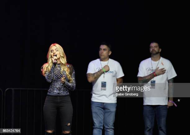 Singer Siena Paglia performs the American national anthem during 'Vegas Strong A Night of Healing' at the Orleans Arena on October 19 2017 in Las...