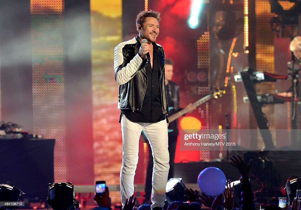 Singer Simon Le Bon from Duran Duran performs on stage at the Milan Music Week World Stage ahead of the MTV EMA's 2015 at Piazza Duomo on October 24, 2015 in Milan, Italy.