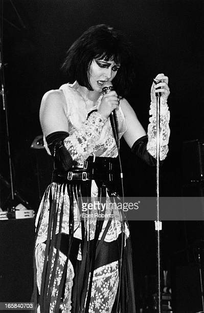 Singer Siouxsie Sioux performing with English rock group Siouxsie and the Banshees USA 1984