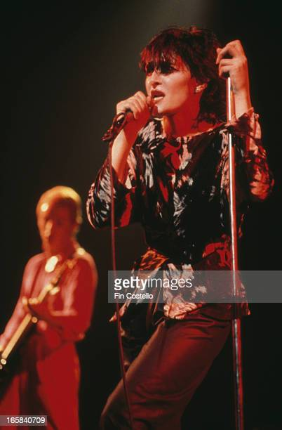 Singer Siouxsie Sioux performing with English rock group Siouxsie and the Banshees circa 1990
