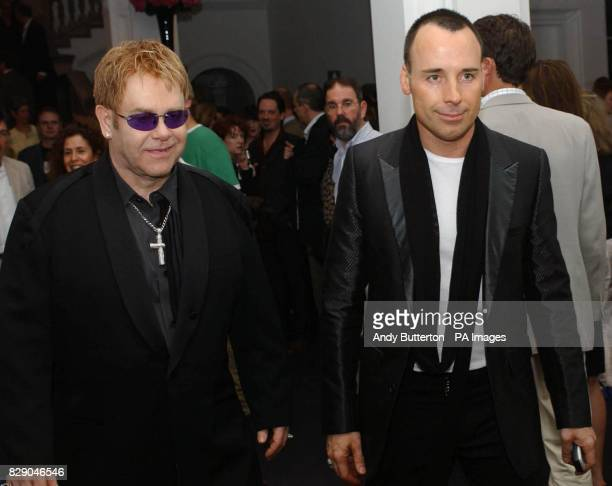 Singer Sir Elton John and his partner David Furnish during the private view of photolondon the first annual art fair in the UK dedicated to...