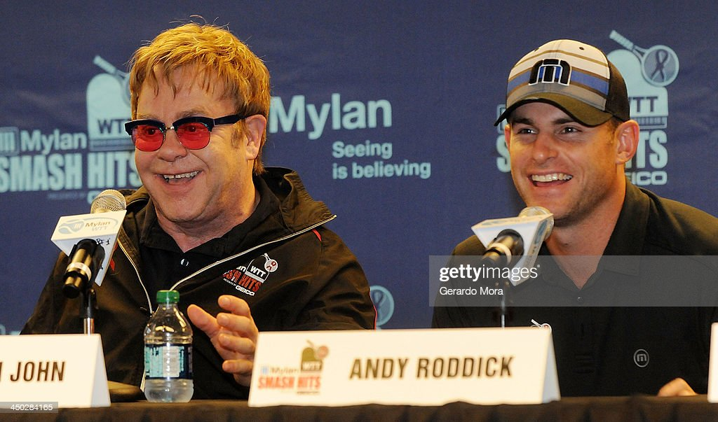 Singer Sir Elton John (L) and Tennis player Andy Roddick smile during the press conference for Mylan World TeamTennis at ESPN Wide World of Sports Complex on November 17, 2013 in Lake Buena Vista, Florida.